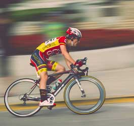 Cyclist in yellow and red